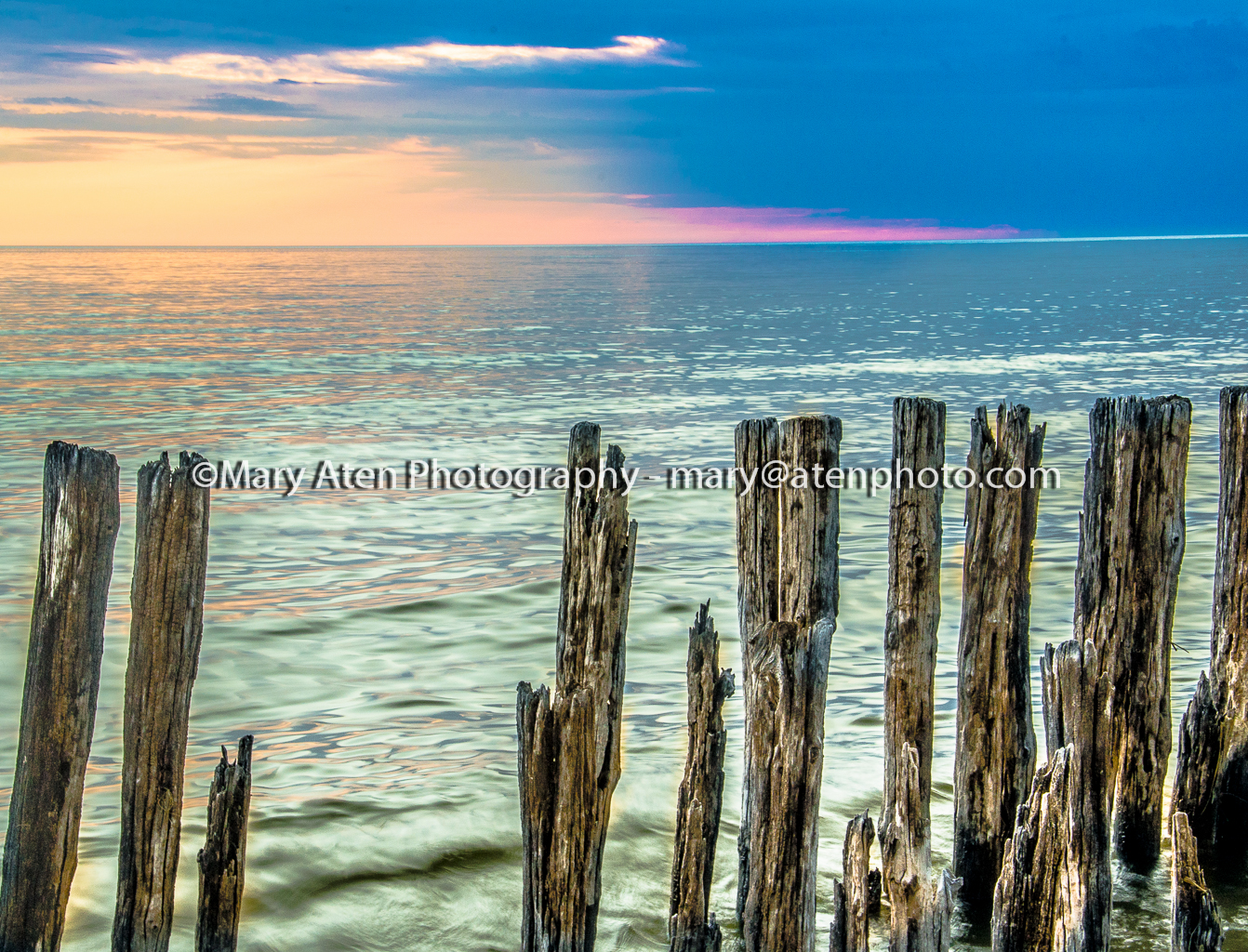 Photo Of Pastel Sunset On Water And Jetties Mary Aten