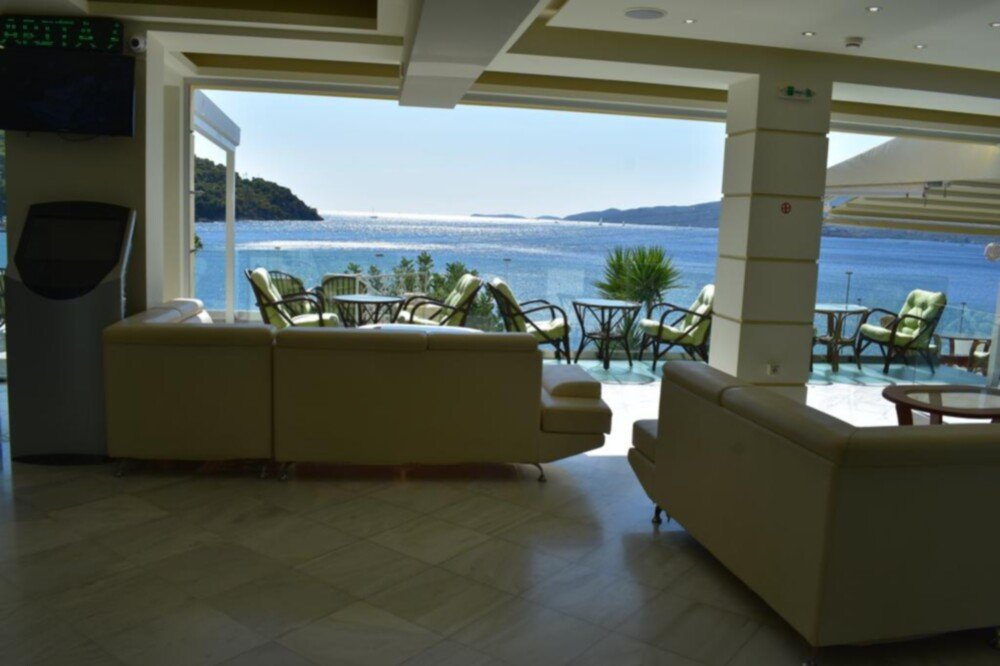 Athens Airport (ATH) transfers to/from New Aegli Resort Hotel with taxi. minivan. minibus. van. limousine. cab. shuttle