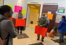 manifestación, locatarios, mercado