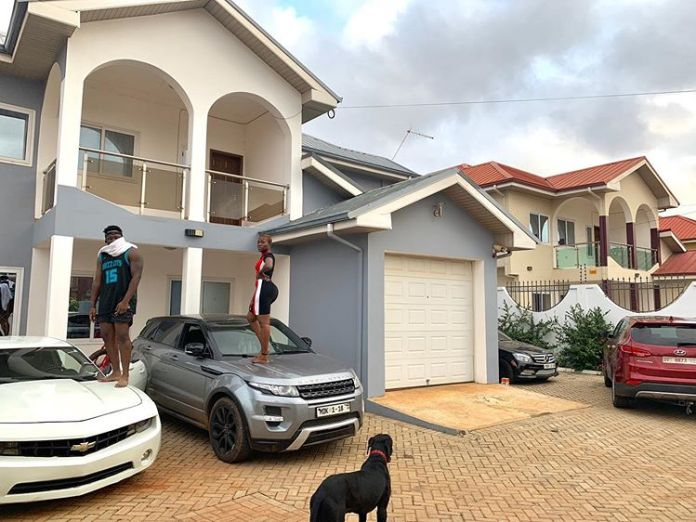 Fella makafui and Medikal pose in her Mansion