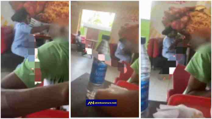 couple Ignore housemaid while they eat with their kid