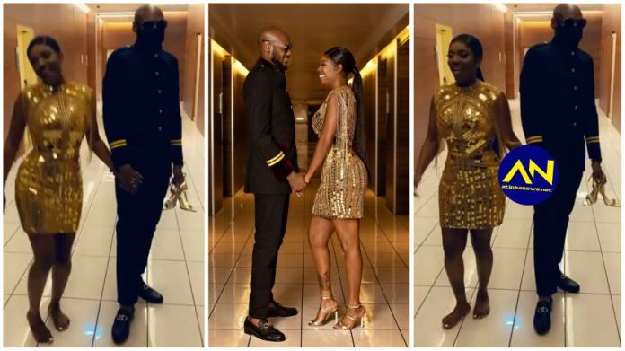 Video of 2baba holding  wife Annie Idibia shoes