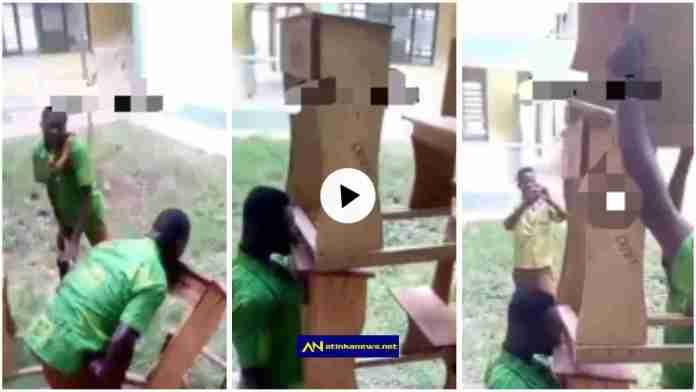 student carries three desks