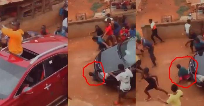 Fresh graduate runs over man while spraying cash in celebration