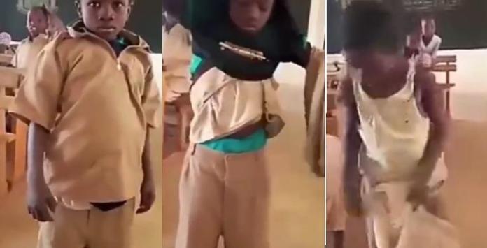 Primary school boy wears many clothes under school uniform