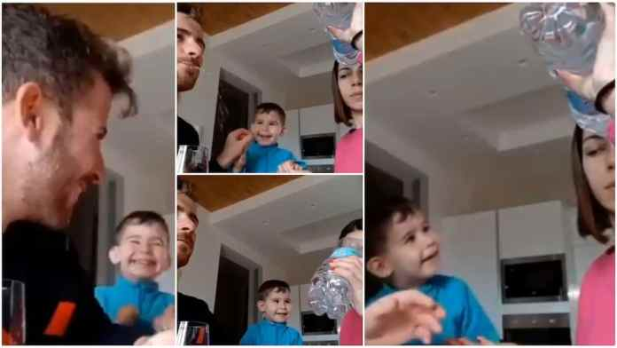parents performing 'magic' with water to make their little kid laugh