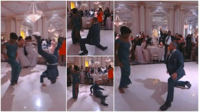 Man almost breaks his neck with powerful dance moves at a wedding