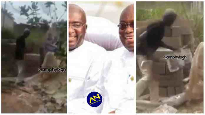Angry man spotted 'whipping' Akufo Addo and Bawumia's poster