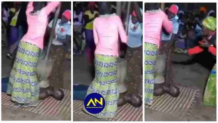 man is being pounded like fufu by strong women for purification