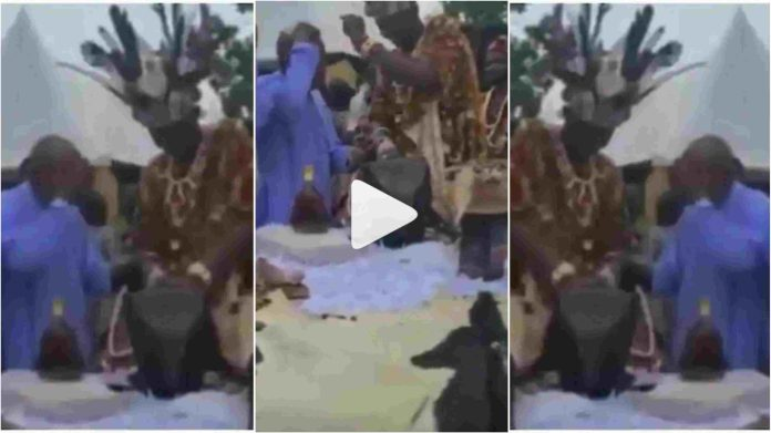 traditionalist is seen spraying money on Reverend Father