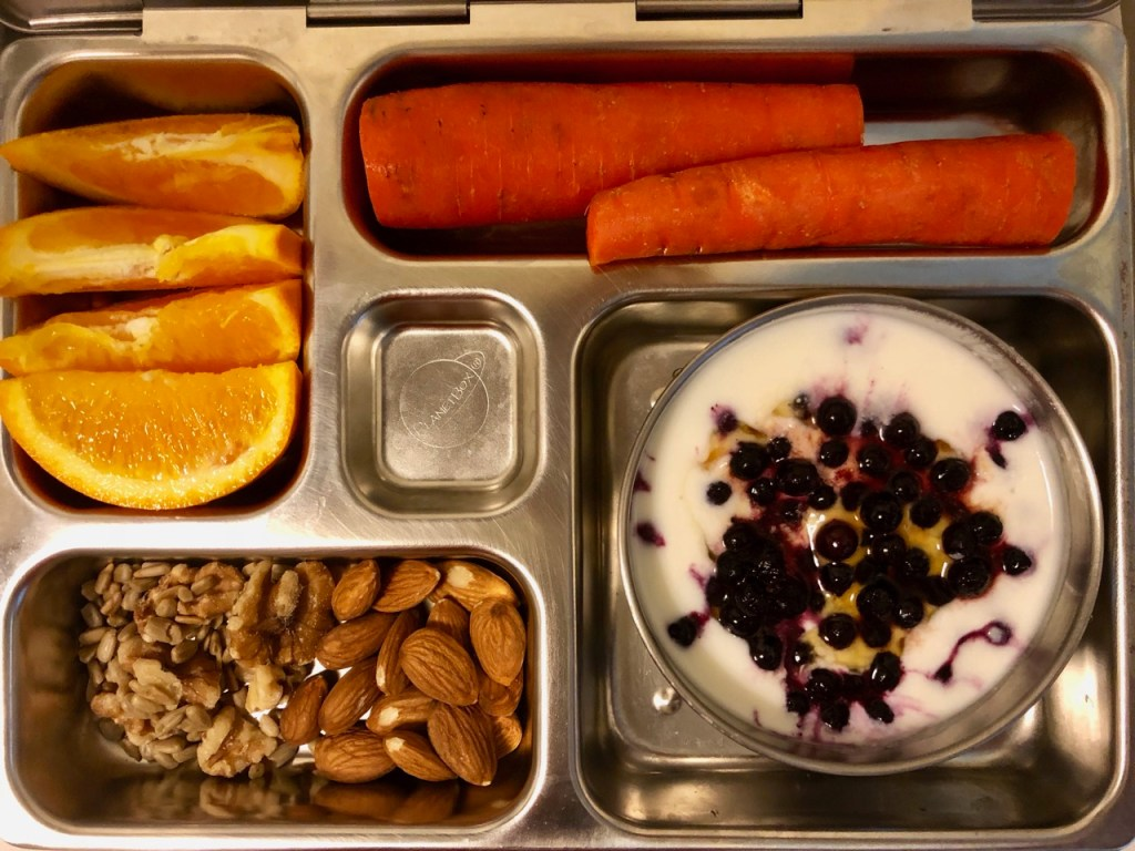 Yogurt with blueberries and honey / almonds, walnuts, sunflower seeds / carrot / orange slices