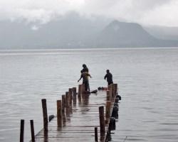Kids Fishing at the dock Panajachel Lake Atitlan