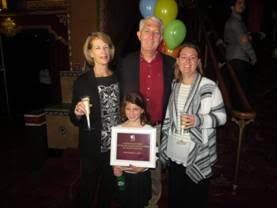 The Fox Theatre's 50 millionth guest, Steven Hensley, of Marietta, accompanied by (from left) his wife, granddaughter & daughter. Photo courtesy of the Fox Theatre.