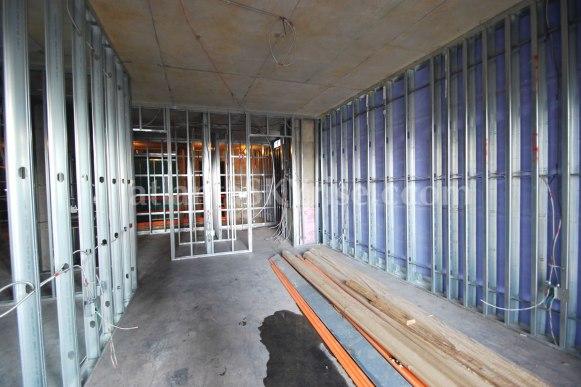 Juniper Floor Plan - Standing in front of the guest bedroom sliders looking toward the bathroom and walk-in closet.