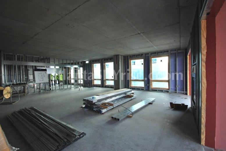 Juniper Floor Plan - Standing in the living room by the sliding glass doors looking toward the kitchen.
