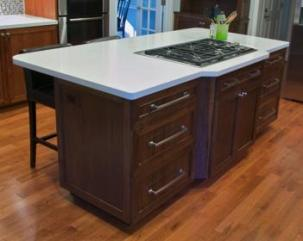 On both sides of the walnut island, we installed three sets of drawers mounted with full-extension, under-mount slides.
