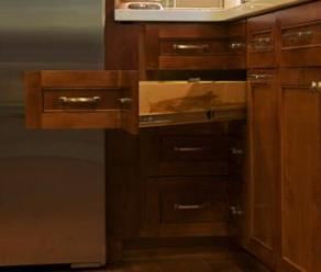 Angled drawers were built to maximize the space in the lower corner cabinet.
