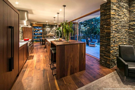 Kitchen, shot from the seating area; in this open plan design, the kitchen and living areas flow together.