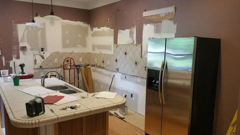 partially stripped kitchen