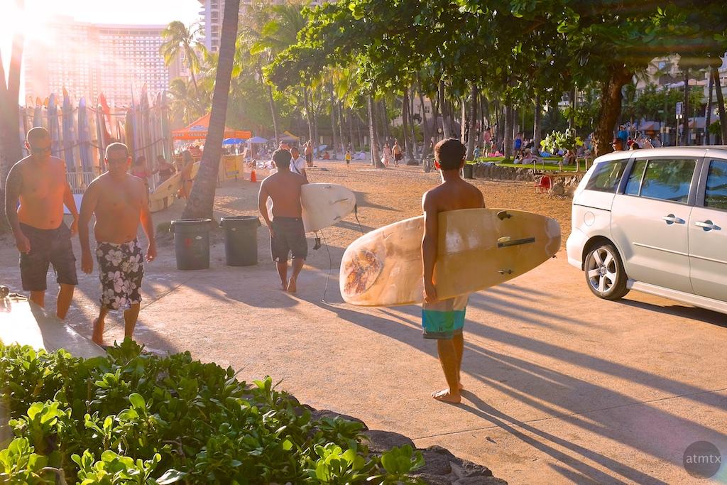 Surfers into Sunset, Waikiki Beach - Honolulu, Hawaii