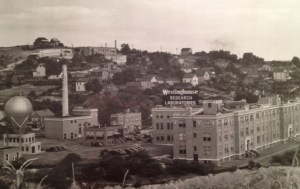 A view of the Westinghouse Research Laboratories in Forest Hills, PA, shortly after the 1937 construction of the atom smasher (at left). Photo courtesy of the Senator John Heinz History Center, Detre Library and Archives.