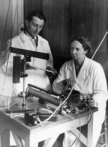 Frederic Juliot-Curie and his wife, Marie at their laboratory at the College of France
