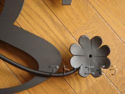 イニシャルDとSに四つ葉のクローバーを組み合わせてデザインしたおしゃれで人気のロートアイアン風アルミ製オーダー妻飾りの写真