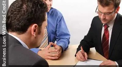 Image of men signing paperwork