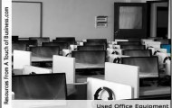 Image of an empty office full of cubicles and office equipment