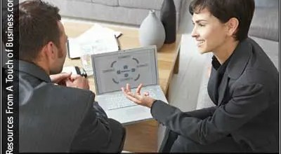 Image of people talking on an office