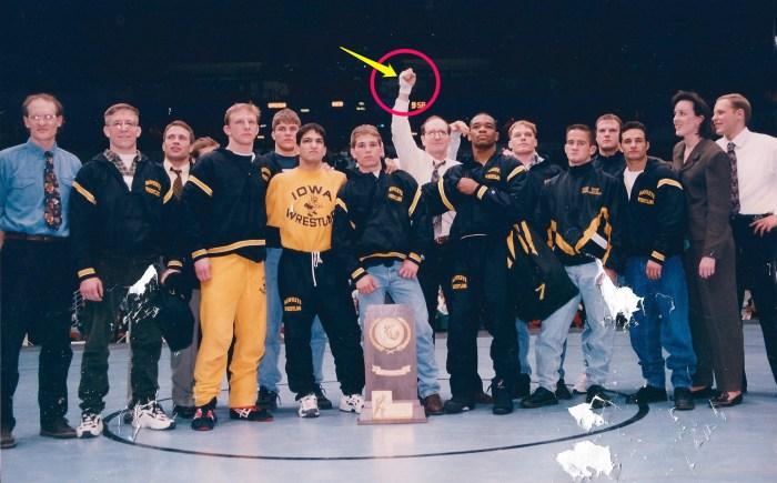 1996 NCAA Championship Team Photo circling hand tape