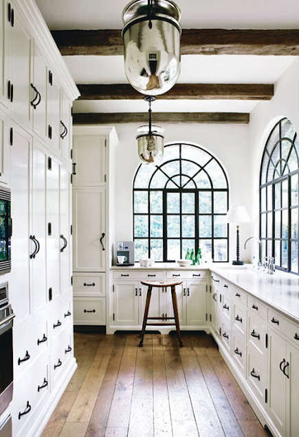 black kitchen cabinet pulls small space table and chairs hardware how finish becomes a design element for white