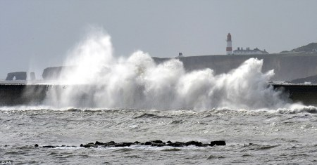 1408356484547_wps_18_Waves_crash_against_the_p