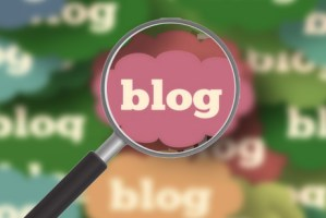 focused blog in magnifying glass