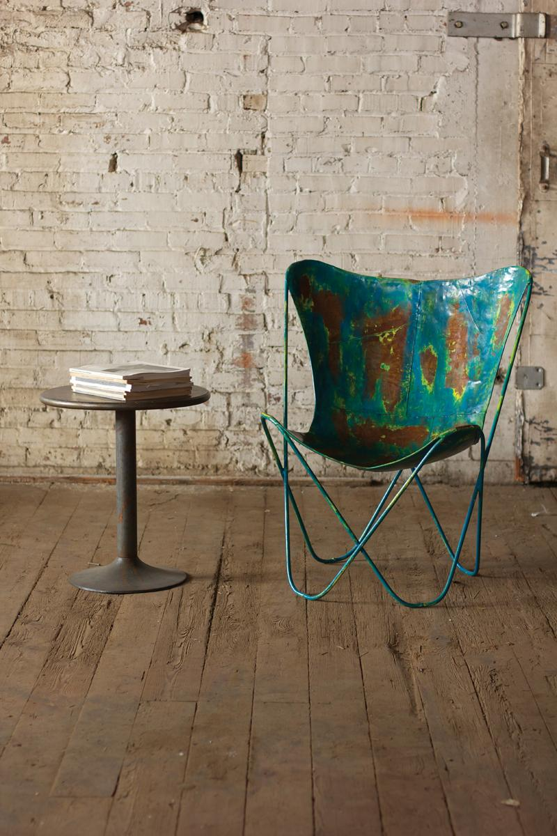 iron butterfly chair in distressed blue finish