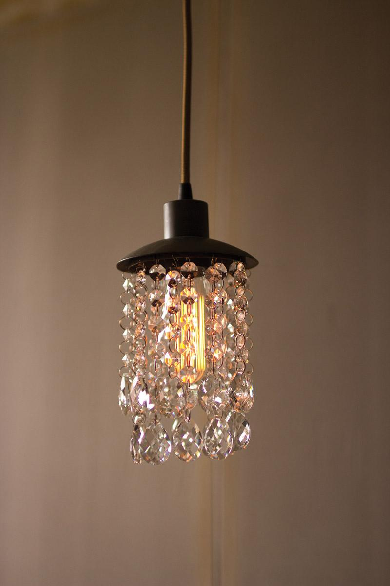 raw metal pendant light with hanging gems
