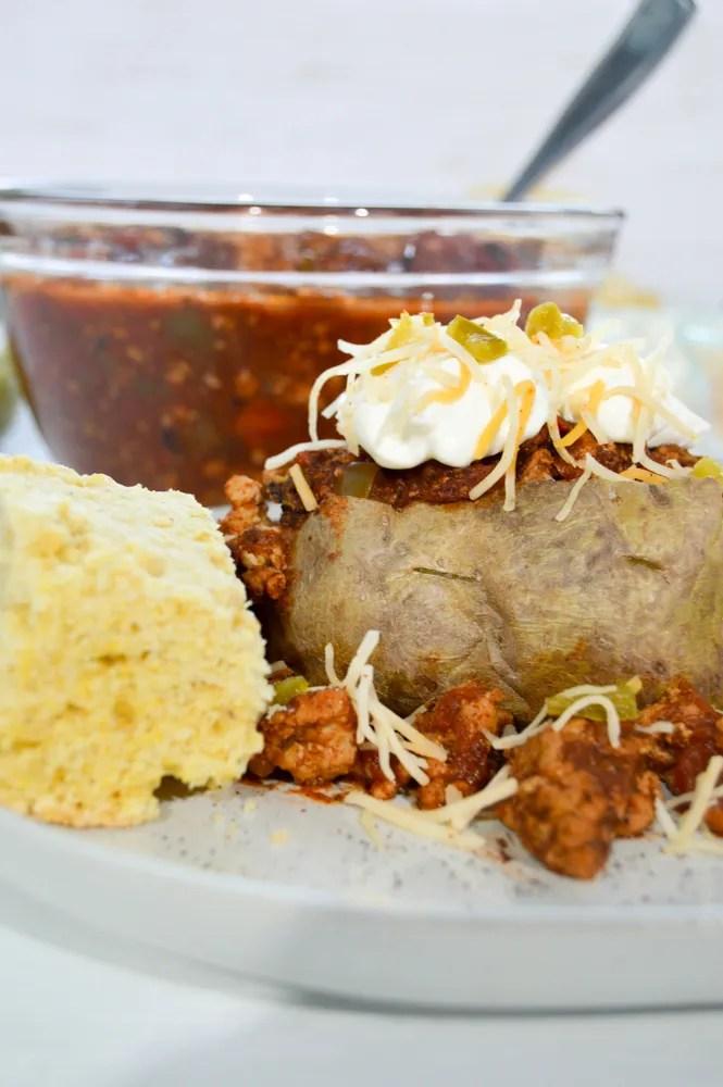 Whole 30 Turkey Chili stuffed into a Baked Potato cooked in a croc pot. Beanless Turkey Chili, Whole30, https://www.atwistedplate.com/turkey-chili-stuffed-potato/