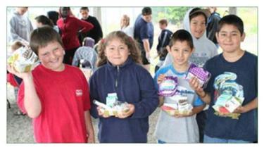 Auburn students enjoying summer food program.