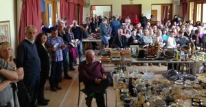 A full room of bidders at Itchen Abbas auction
