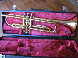 Yamaha YTR-1335 Bb Trumpet hardly used. In special gold-lacquer finish. With case but no mouthpiece.