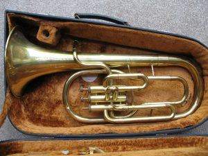 Tenor Horn – Eb – Corton – Foreign with case and music lyre but no mouthpiece. Missing one valve button and 3rd slide is stuck. Otherwise it blows