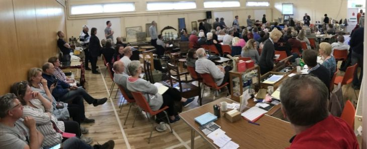 About 75 buyers at the auction in Badger Farm Community Centre