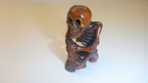 Lot 211 - Wooden Netsuke of a Skeleton - Sold for £30