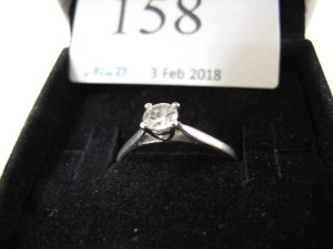 Lot 158 - Clear stone on silver ring - Sold for £35