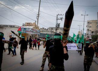 Maskierte Hamas-Mitglieder während einer Kundgebung im zentralen Gazastreifen. Foto Abed Rahim Khatib/Flash90
