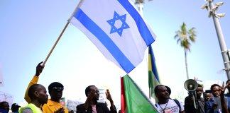 Sudanesen demonstrieren zur Unterstützung ihres Volkes im Sudan im Süden Tel Avivs. Foto Tomer Neuberg/Flash90