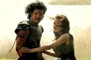 Pictured:  Jon Snow and Emily Browning standing behind a farting Paul W.S. Anderson