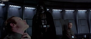 That guy's not scratching his neck.  Vader is choking.  From across the room.  NIGHTMARES.
