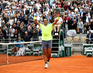 PARIS, FRANCE - JUNE 09: Rafael Nadal of Spain celebrates victory following the mens singles final against Dominic Thiem of Austria during Day fifteen of the 2019 French Open at Roland Garros on June 09, 2019 in Paris, France. (Photo by Julian Finney/Getty Images)