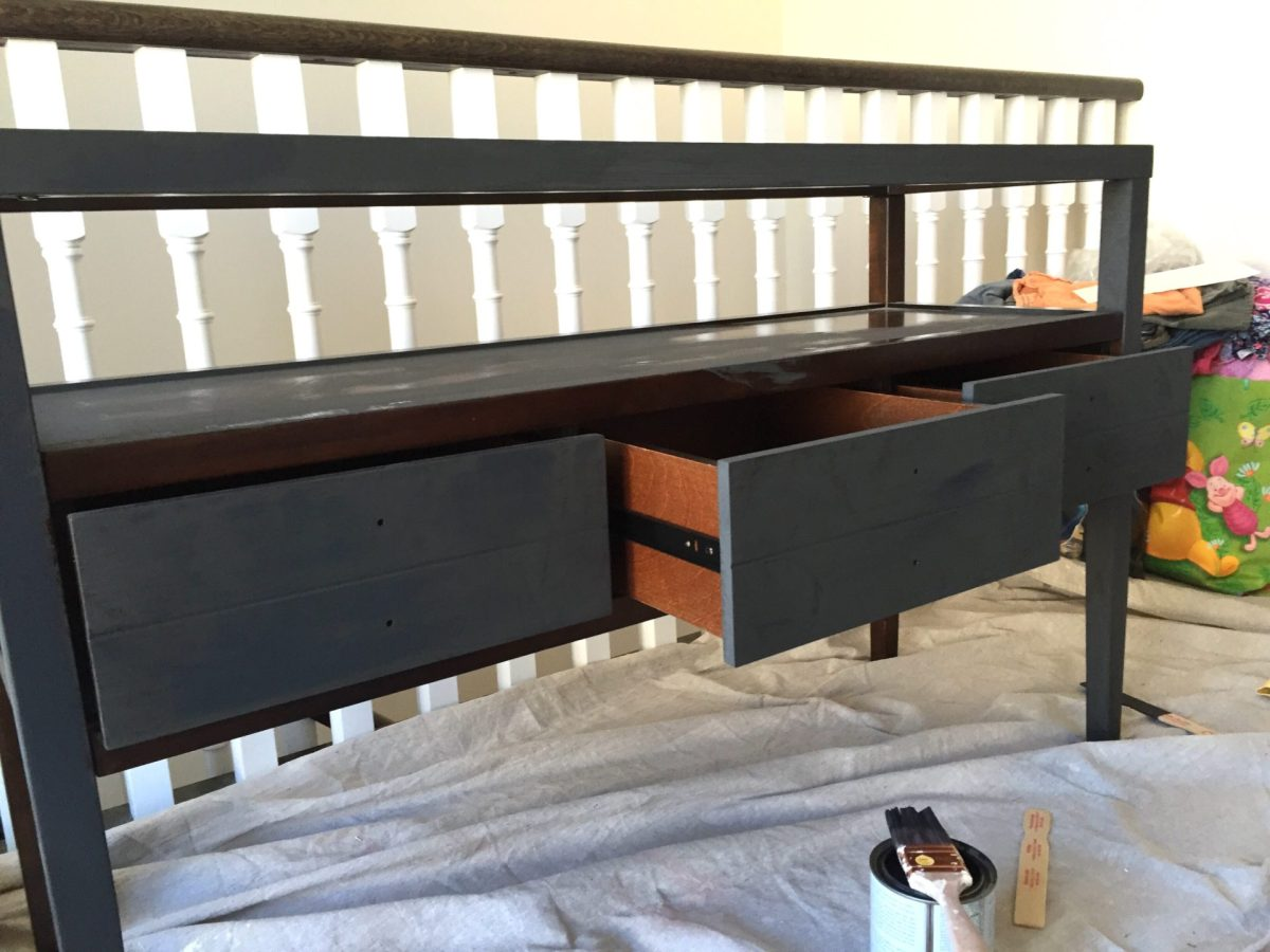 Graphite chalk Paint being applied to a console table
